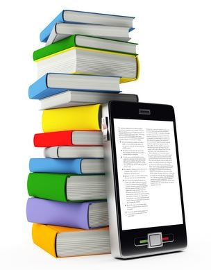 stack of books and ebook reader