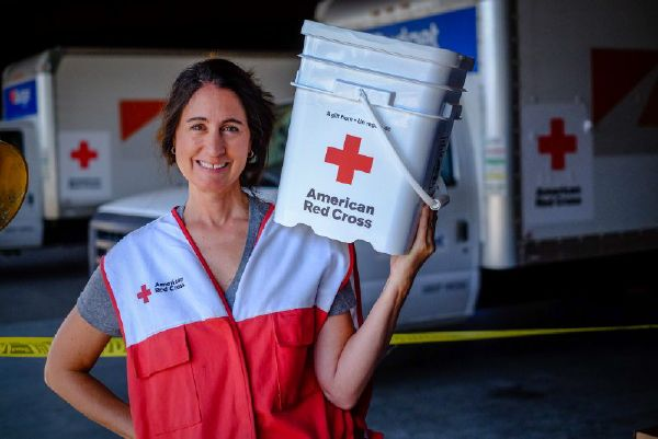 American Red Cross woman volunteer with supplies