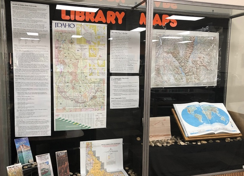 maps in the library in a display case