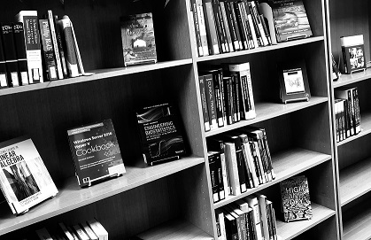 Photo in black and white of the New Books shelf at Oboler Library