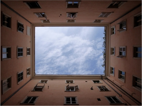 A view of sky from inner courtyard of a building