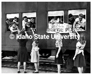 Copyrighted image of girls shaking hands with soldiers through open train windows.