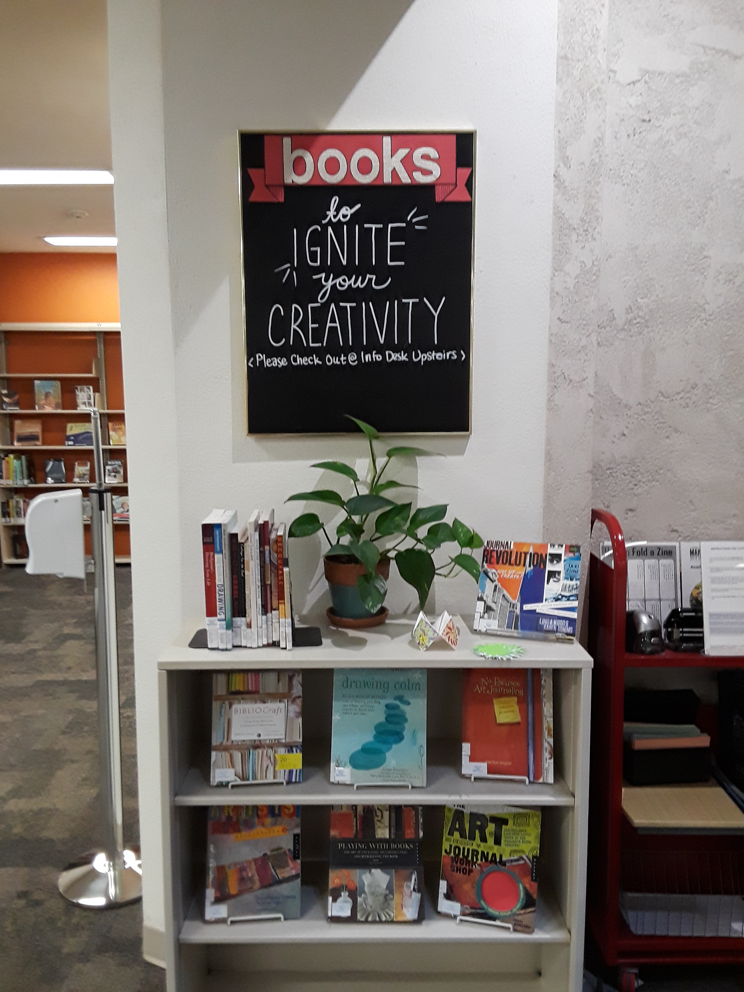 photo of bookshelf with creativity books on it