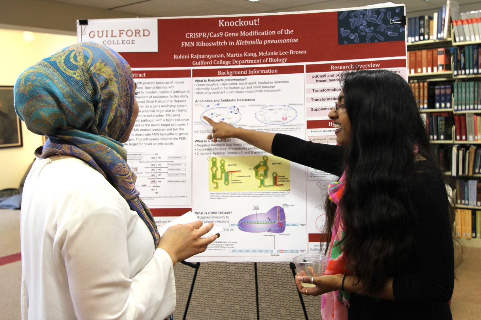 Two students looking at a research poster