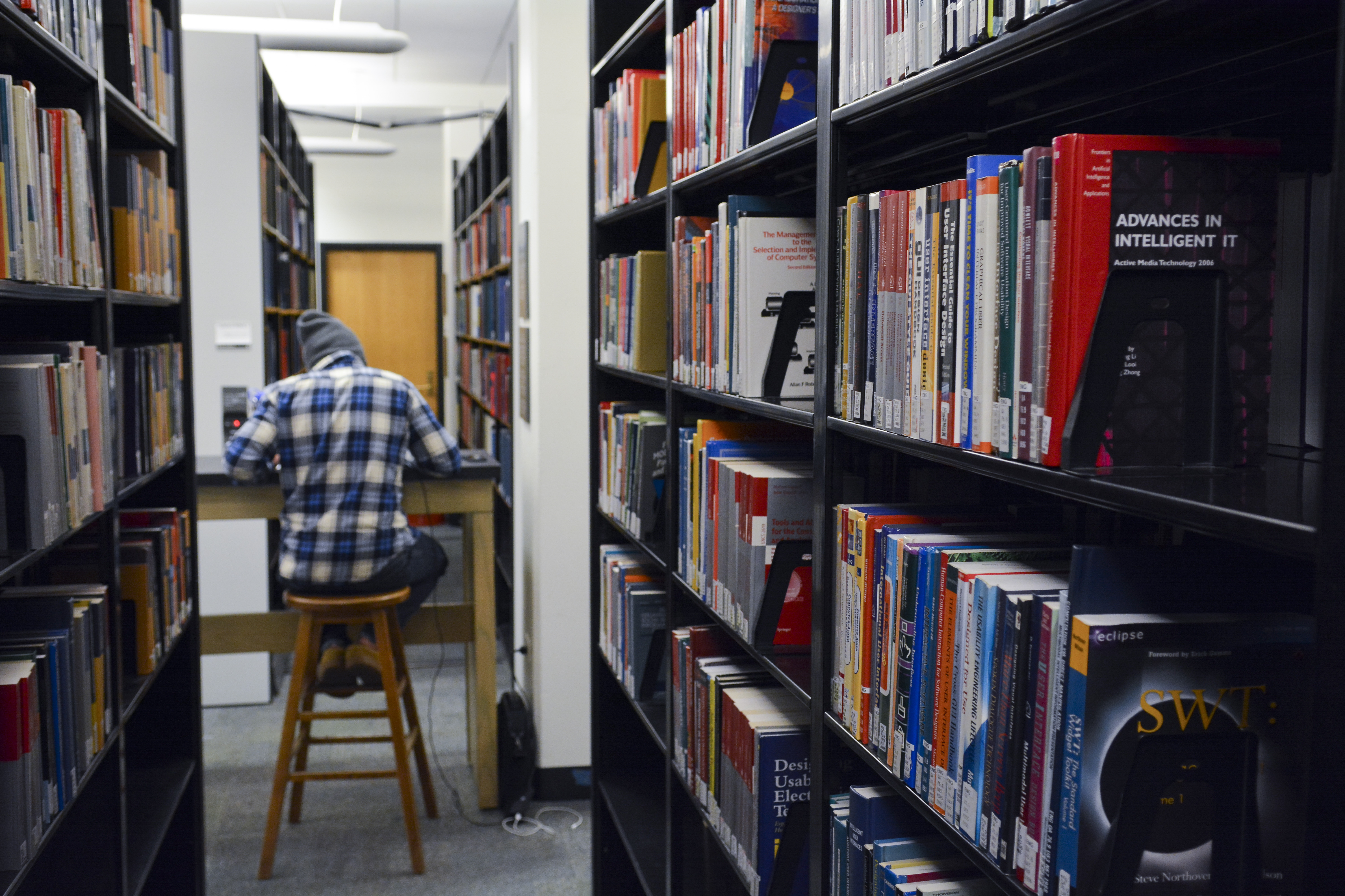 image of student studying on the lower level of the Gemmill Library