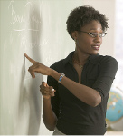 Photo of instructor pointing to blackboard