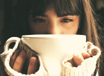 Image of young woman with a cup of coffee