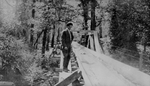 Man next to flume, circe 1900.  Harry Pidgeon collection.