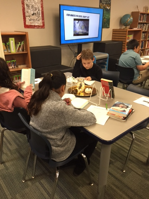 Students reading books at table