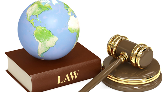 world on law book with gavel nearby