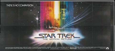 movie poster with Captain Kirk and Spock in a rainbow with Starship Enterprise