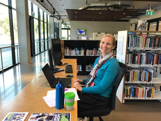 One of our librarians at the desk in Port Macquari