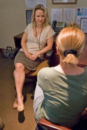 A clinical psychologist talks with a patient