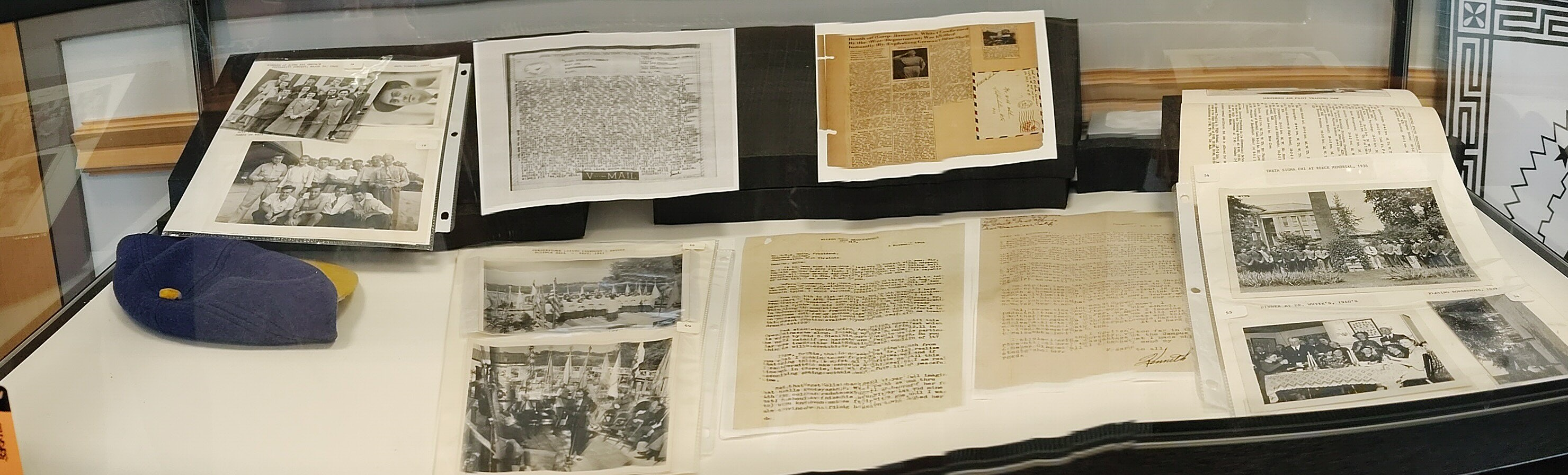 Display in Archive Reading Room showing photos and letters from Shepherd College students and alumni duringWWII