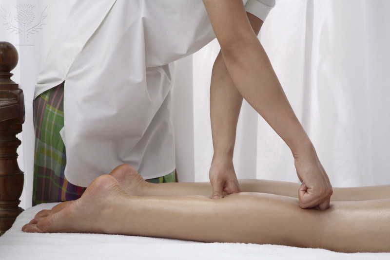 Massage therapist working on a patients leg