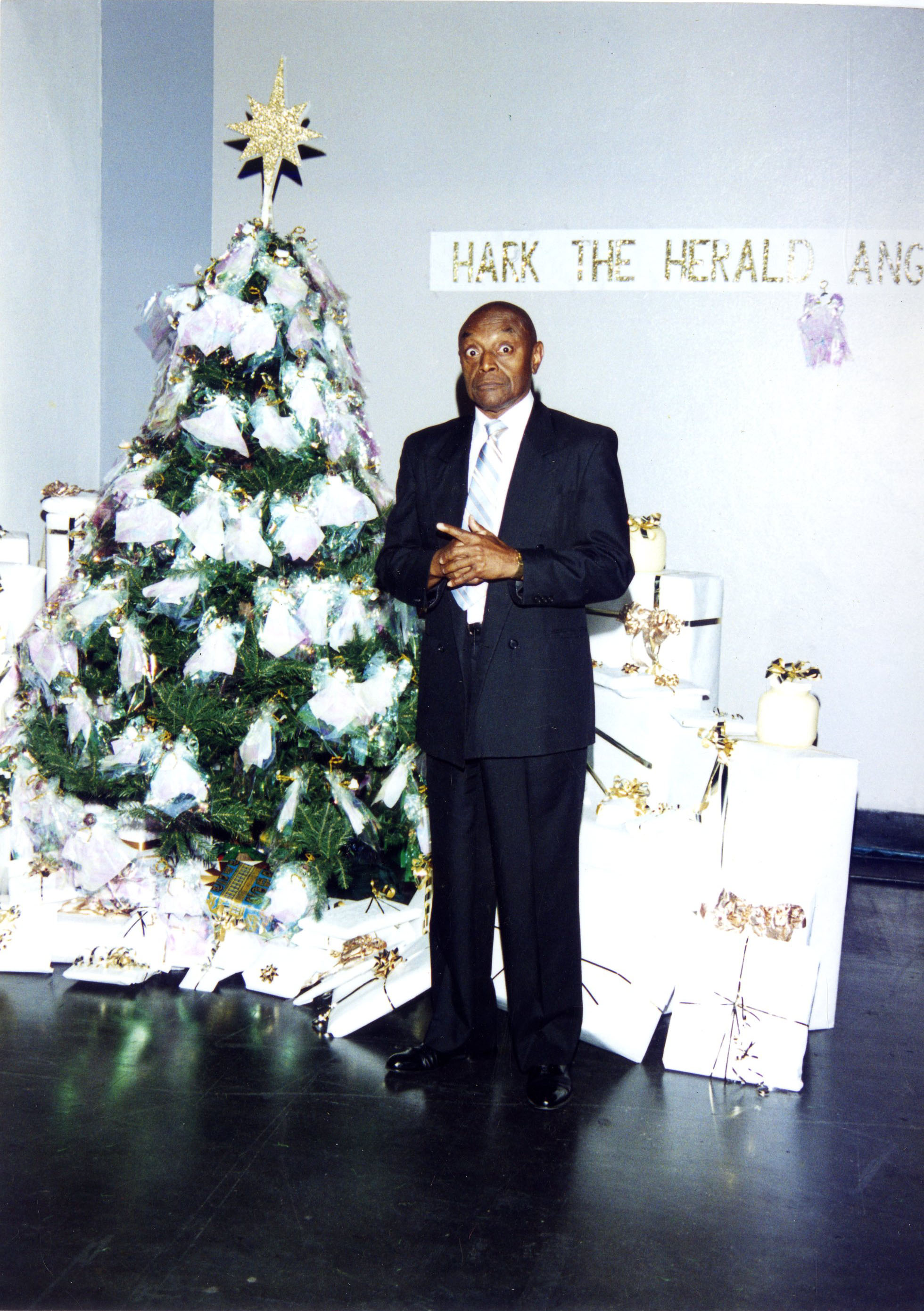 Don Lee White next to Christmas Tree