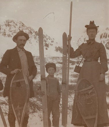 Family in snow with skis