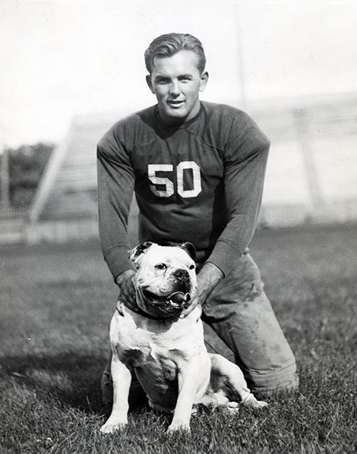 Russ Hale, captain of GU's football team, with mascot, circa mid-1930s
