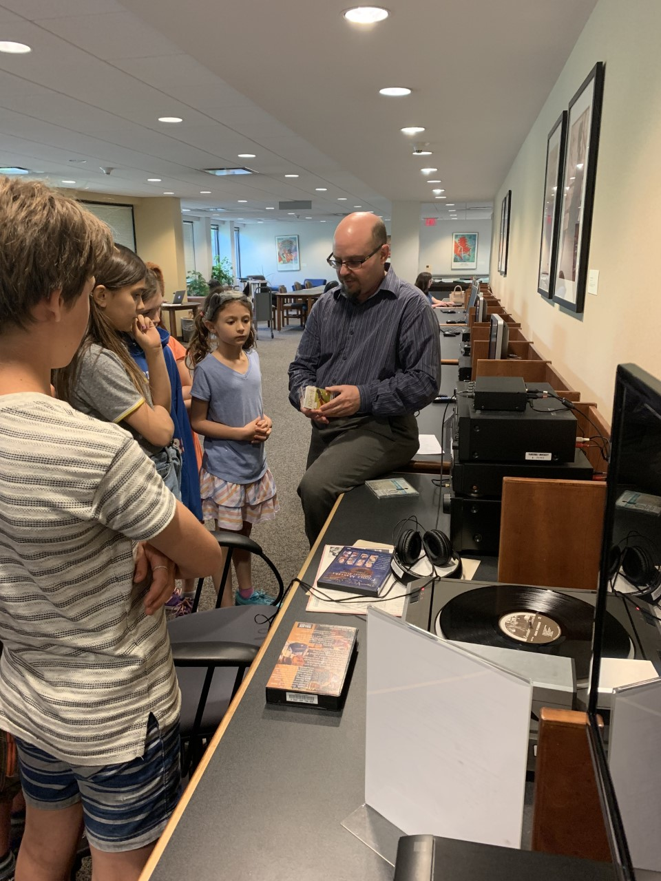 Holling Smith-Borne shows Blair Academy fiddle students how to use audiovisual equipment in the Music Library, April, 2018.