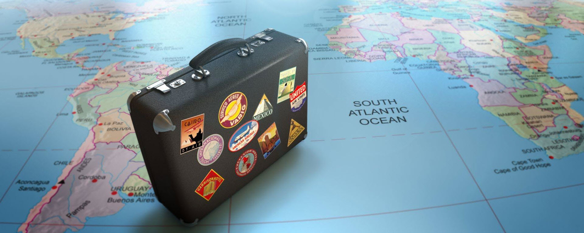 Suitcase sitting on a world map