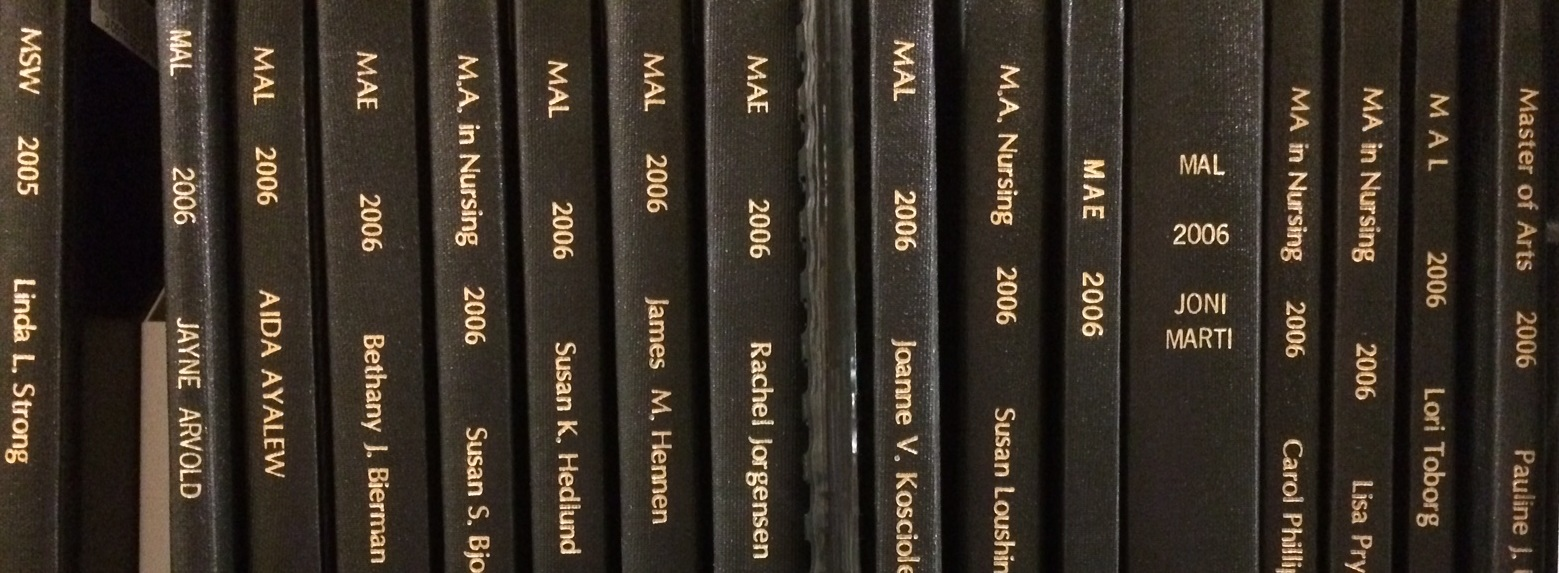 Photo of bound theses on a shelf a Lindell Library
