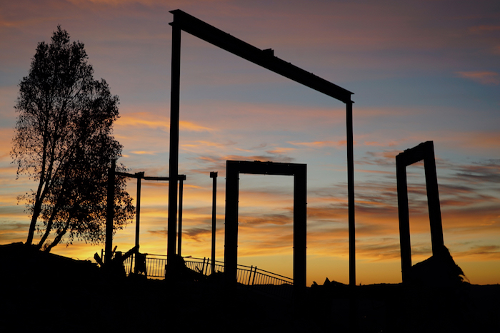 burned out structure frames at sunset