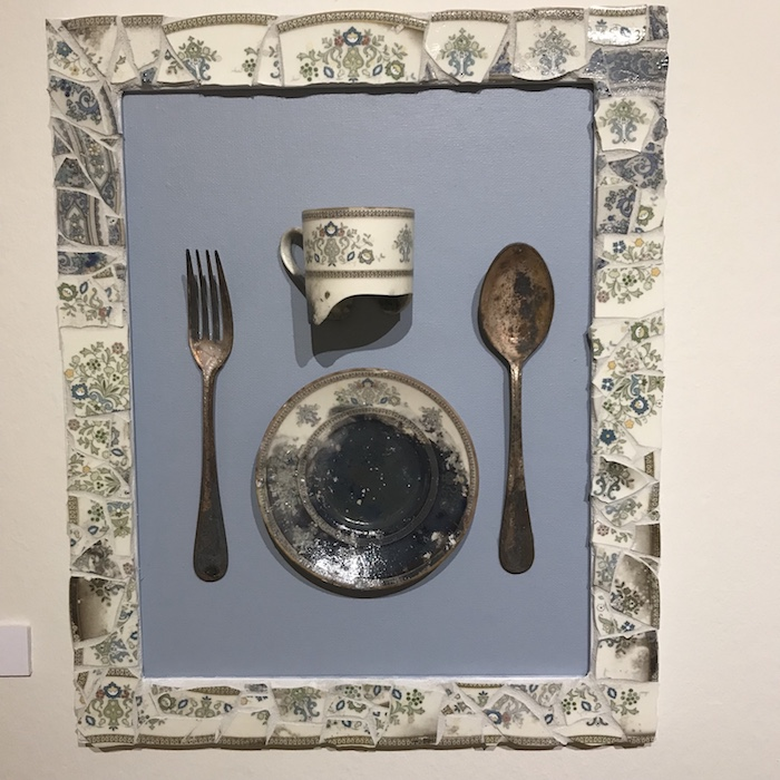 burned flatware framed in broken china