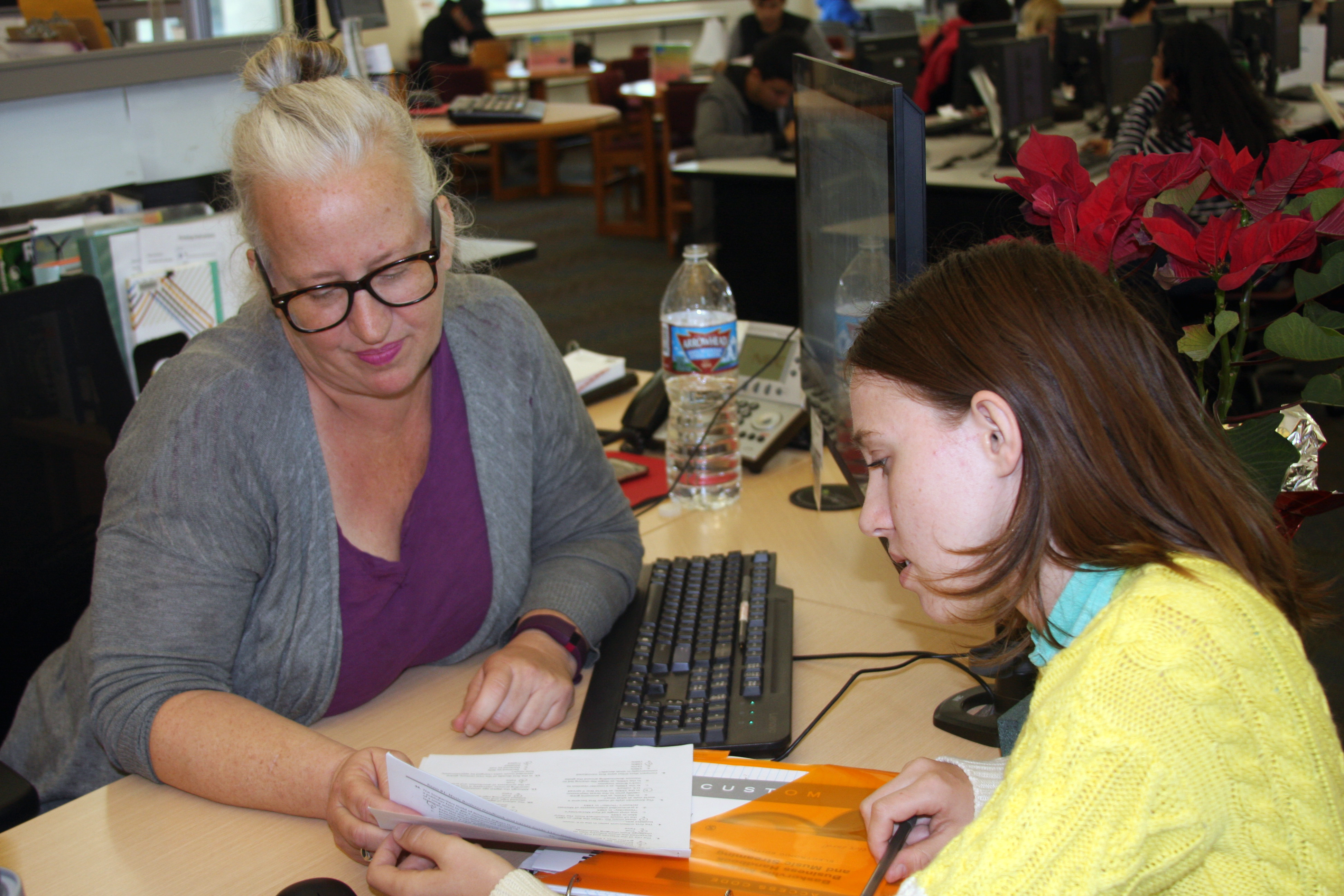 Librarian assisting a student