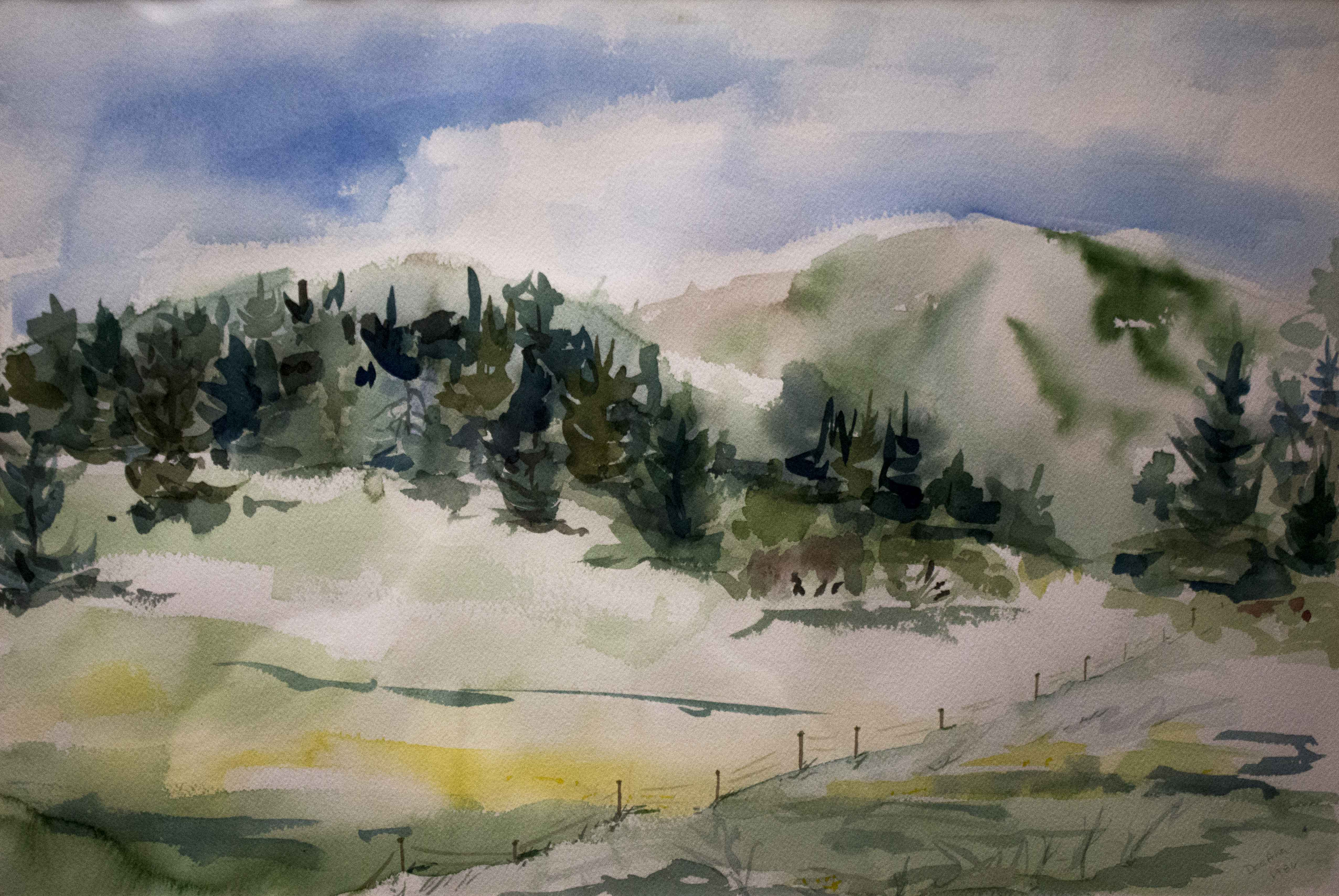 watercolor landscape of a distant treeline and mountain