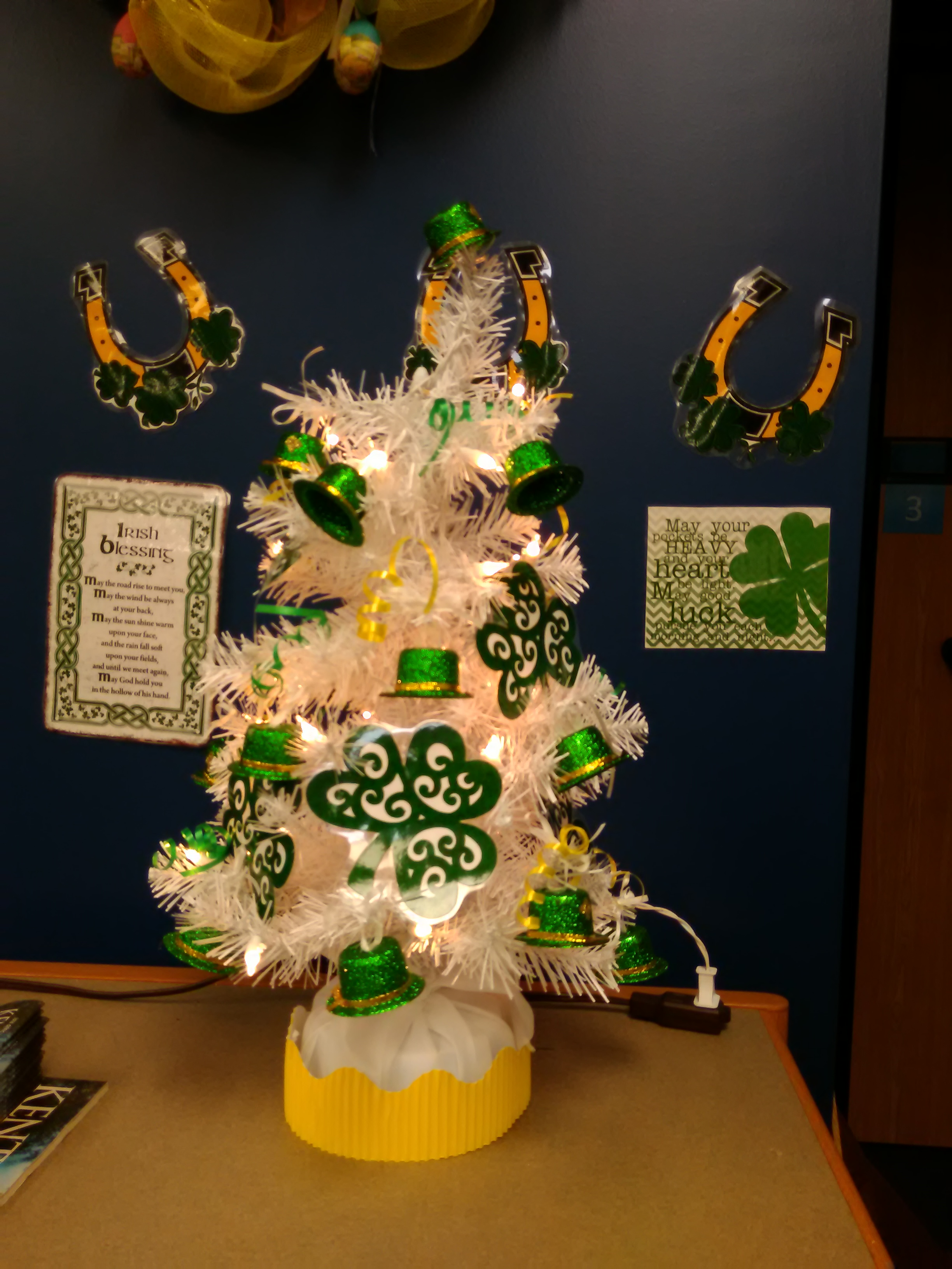 White tree with St. Patrick's Day clovers and tiny green hats in Gov Doc's