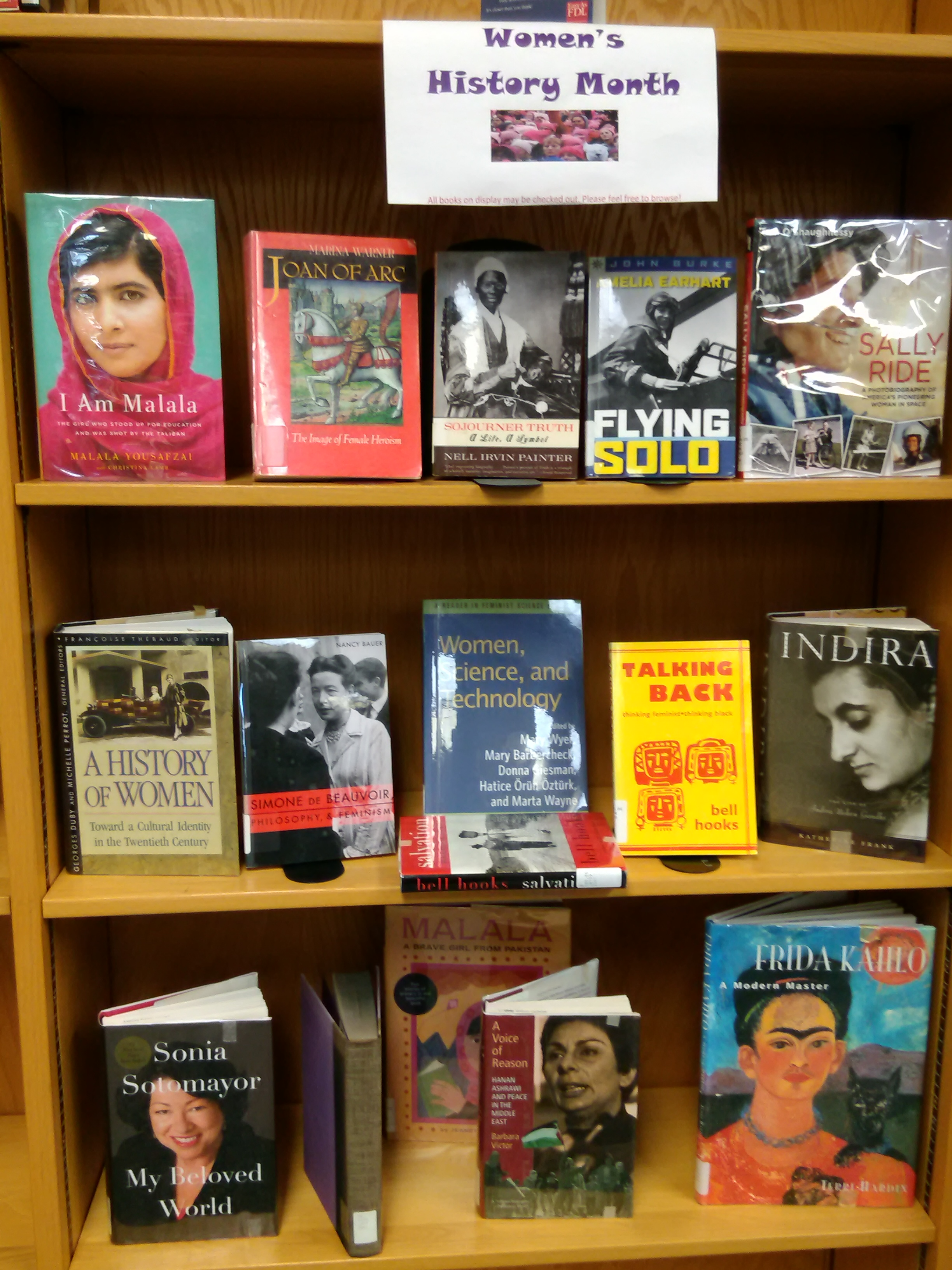 Books from our library's collection of influential women