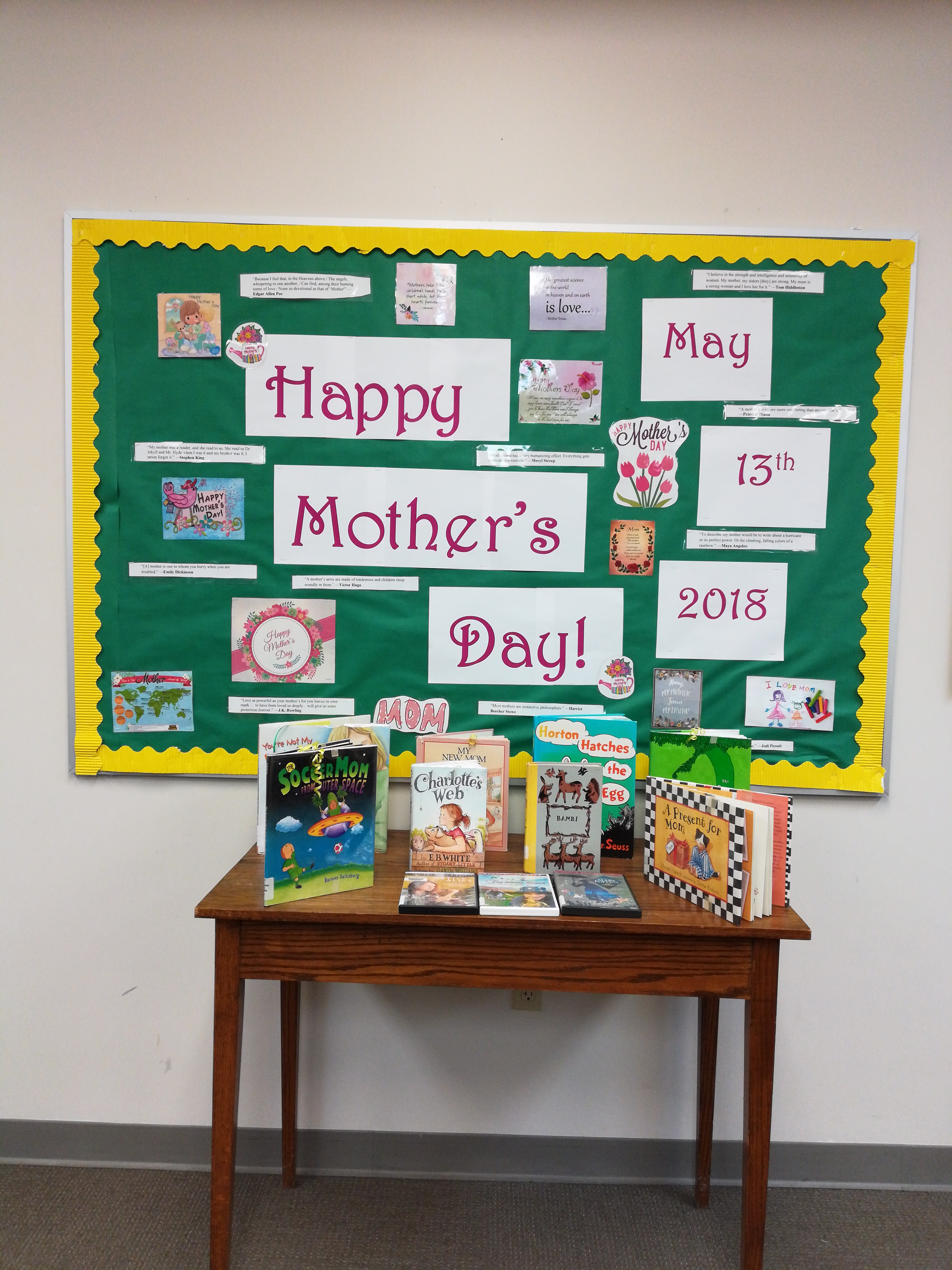 Mothers Day board display with books from our collection