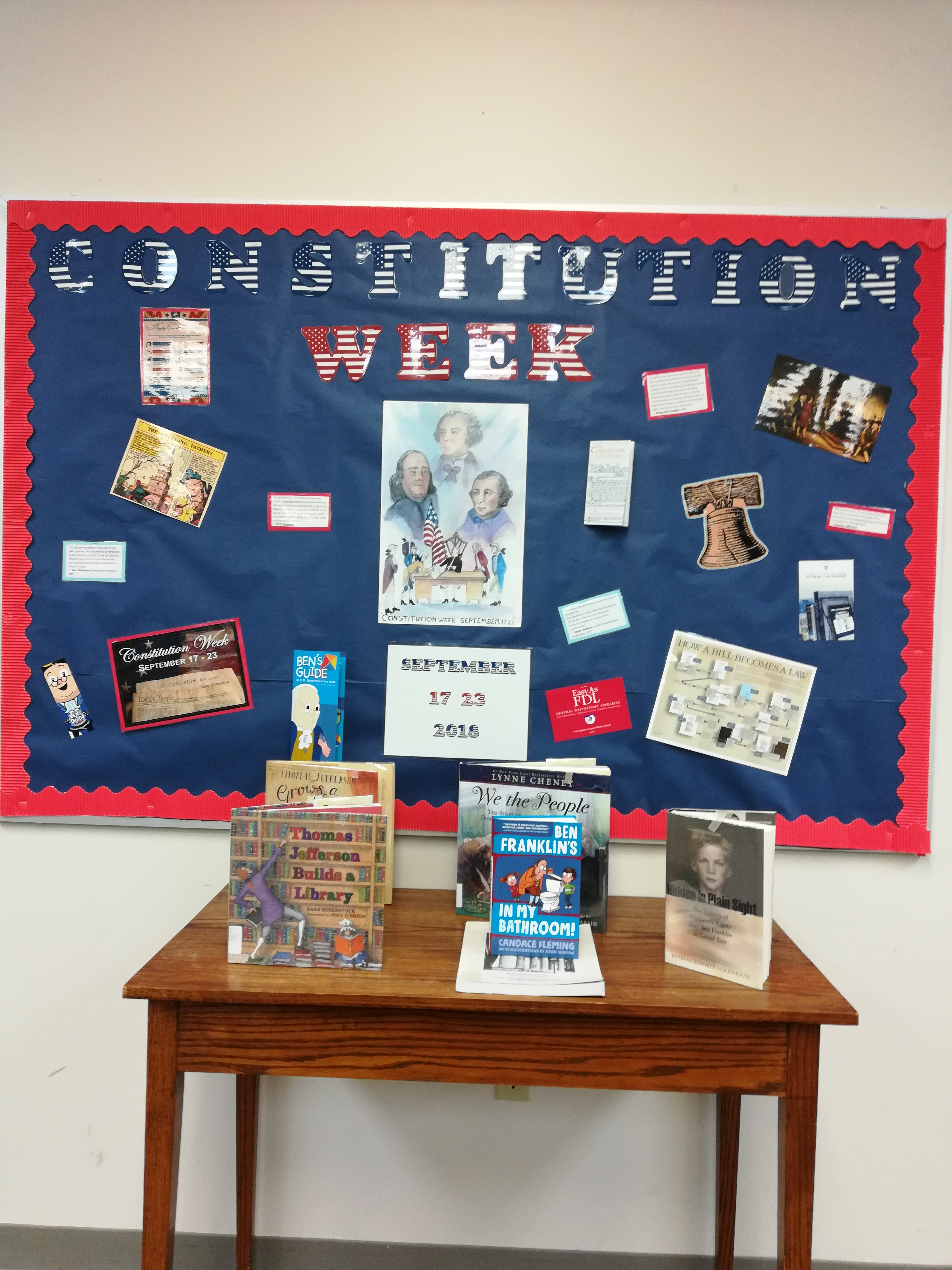 Constitution Week Board and display with books from our collection. Red White and blue lettering on a navy background