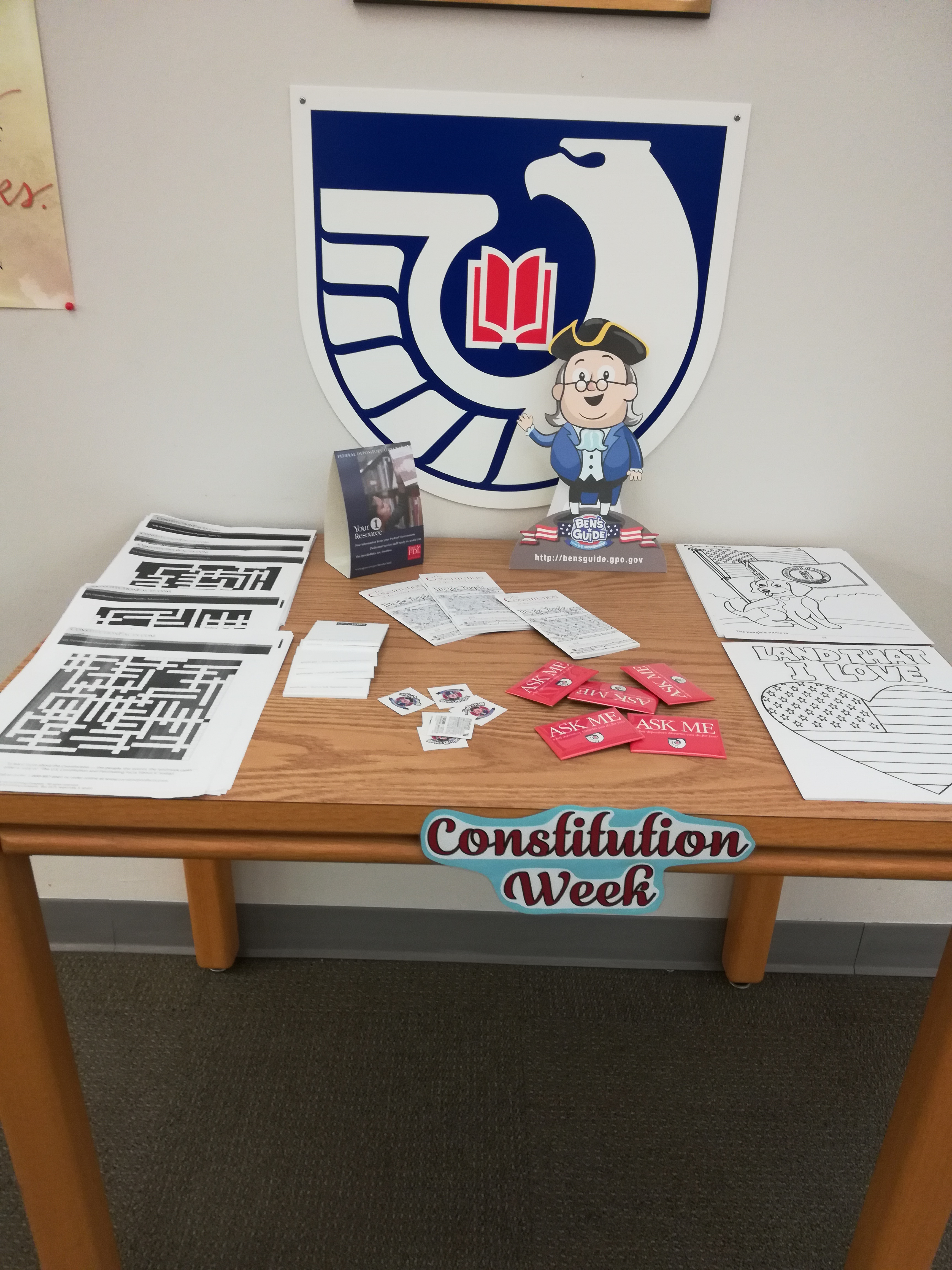 a display with work searches, coloring sheets and freebies (stickers, pins and more!) for students to take