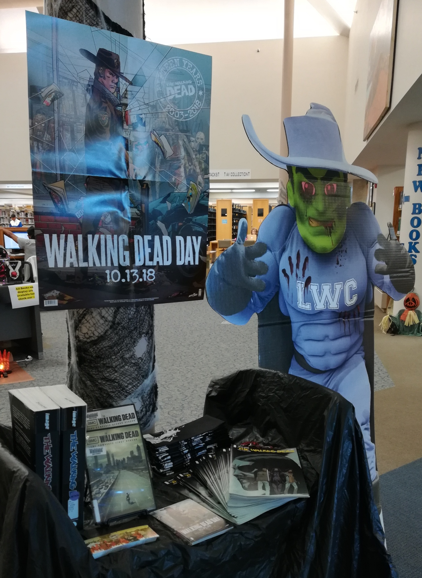 Walking Dead Day display with Zombie Blue Raider Bob and freebies