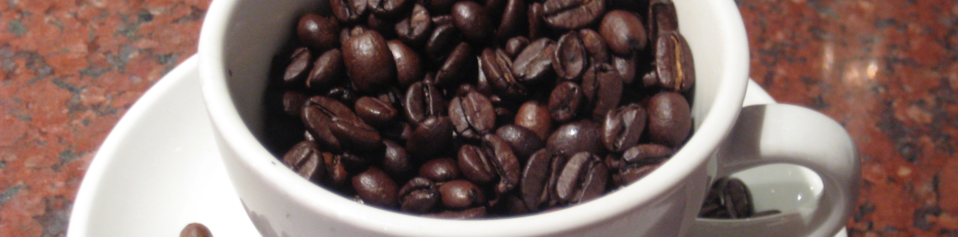 cup of coffee with coffee beans.
