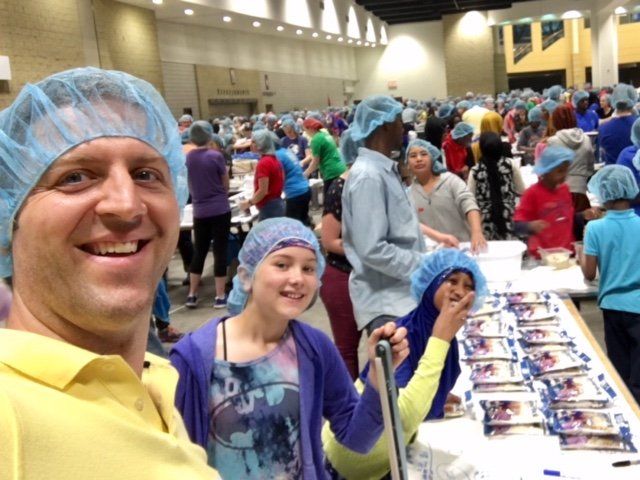 Shawn and his daughter at Feed My Starving Children