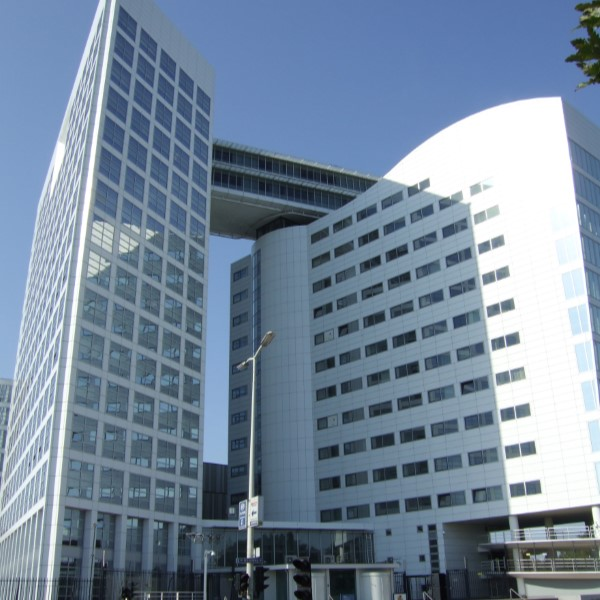 the international criminal court in the hague on a sunny day.