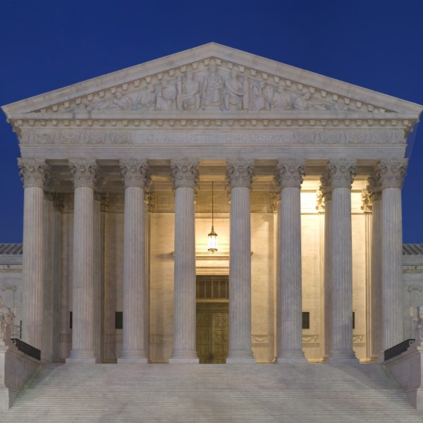 The US Supreme Court Building at Dusk.
