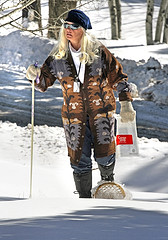 Census worker walking in snow with snowshoes.