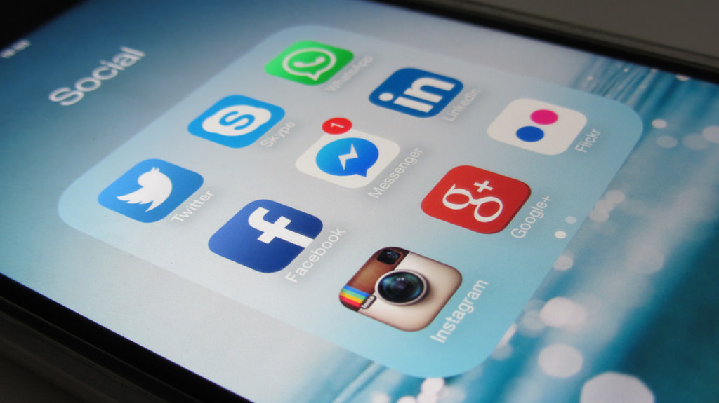 Image of an iPhone screen with social media app icons.