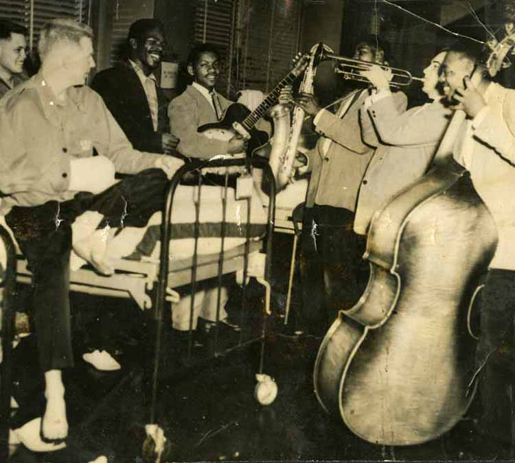 photo of Lloyd Price and band playing to wounded military