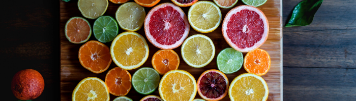 Different types of sliced citrus on a cutting board