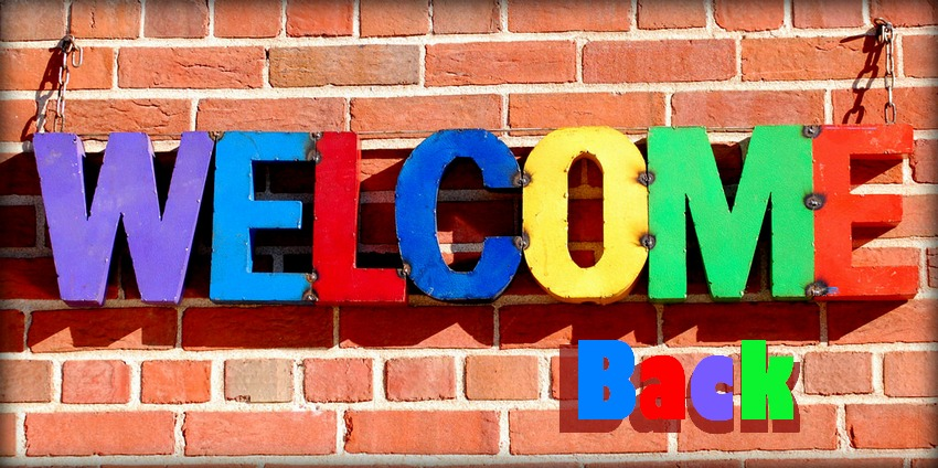 Colorful welcome back letters on a brick background