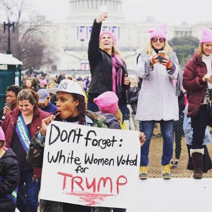 "Protest sign: ""White Women Voted for Trump"""