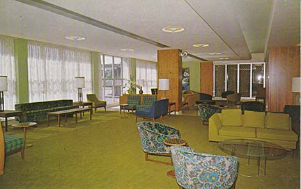 Postcard view of the Loretto Hall (now Austin Hall) living room taken shortly after opening in 1965