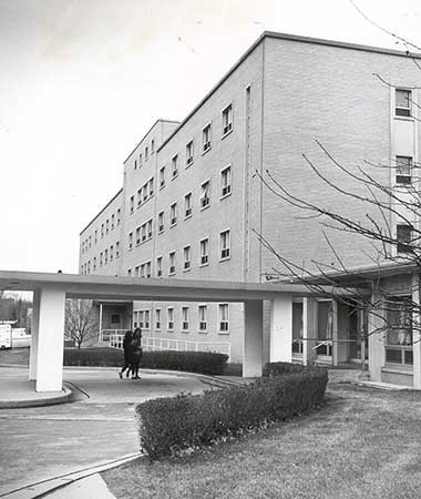 This is an exterior shot of the west side of Clare Hall taken in 1957. The carport can be seen.