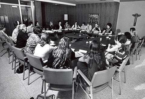 This photo shows the first Conference of Women Theologians in session in the lounge are of Clare Hall in 1971.