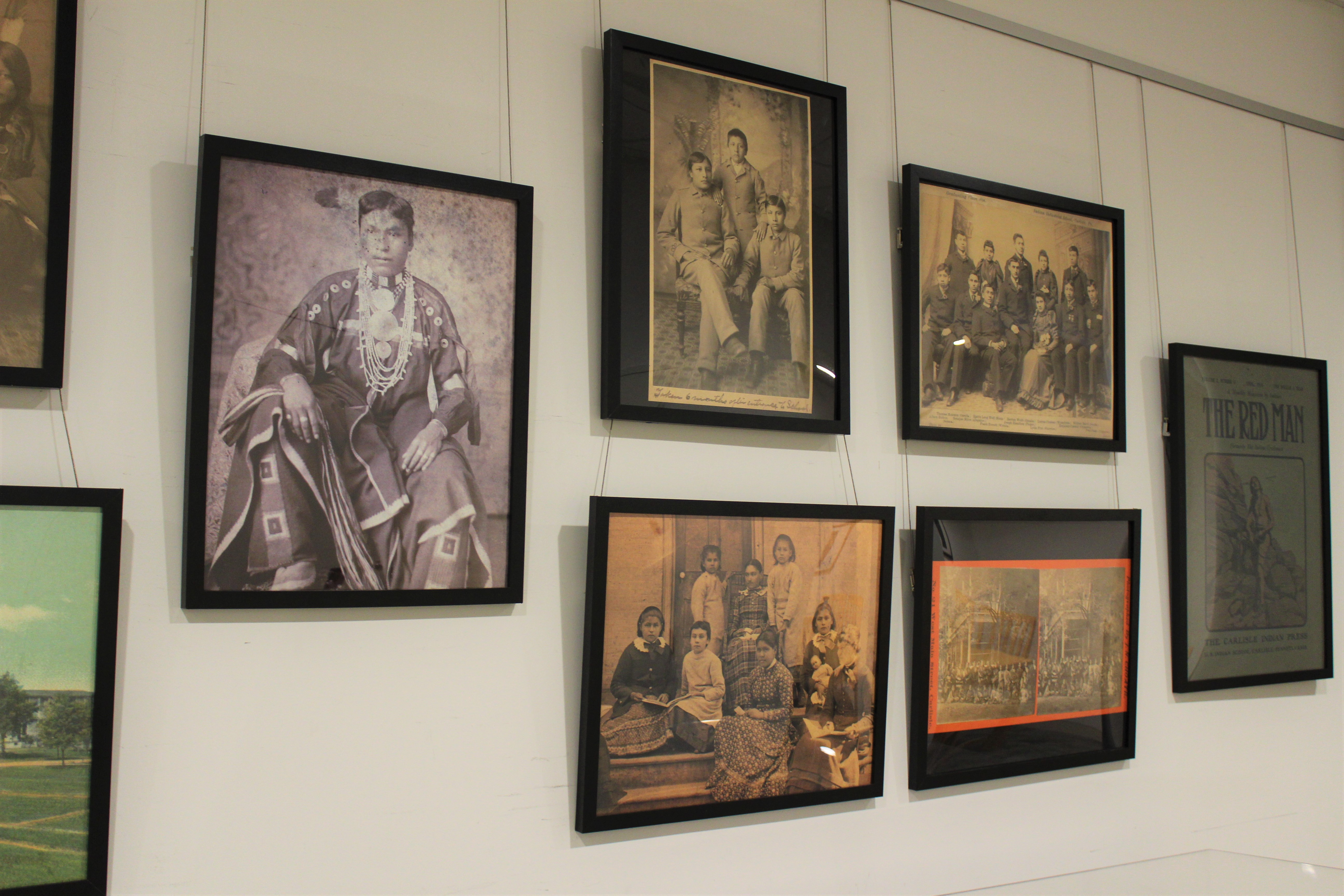 Hanging photos of various native americans
