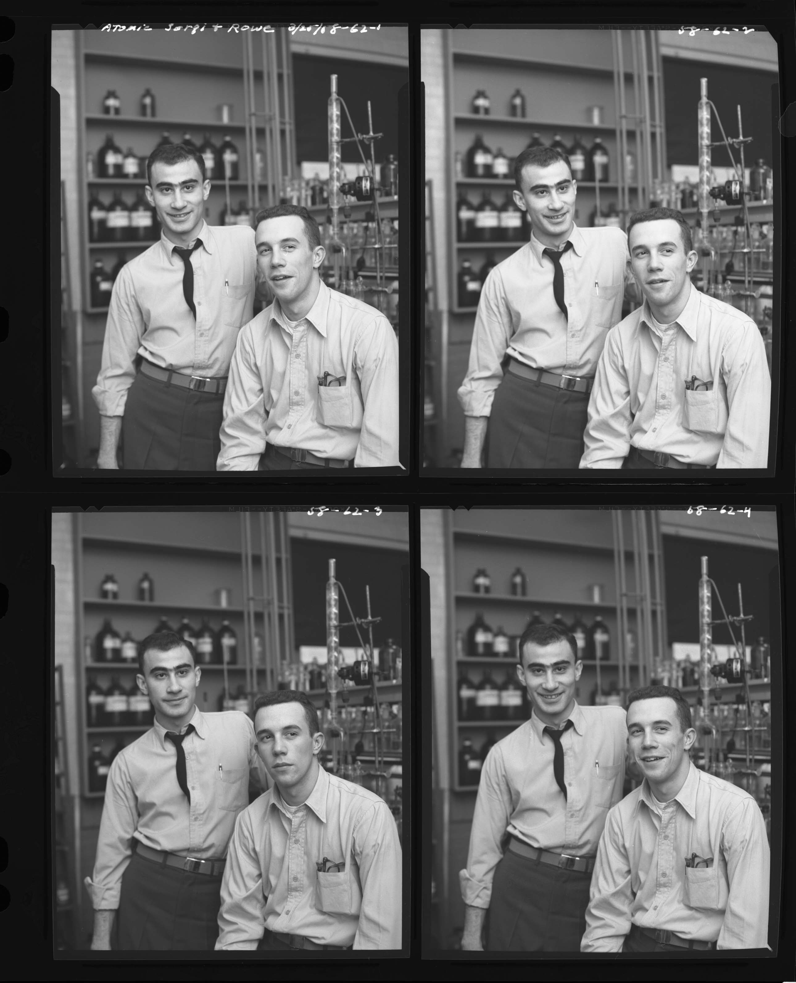 Four frames of two men posing in a science classroom